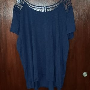 Blue blouse with lace accent.